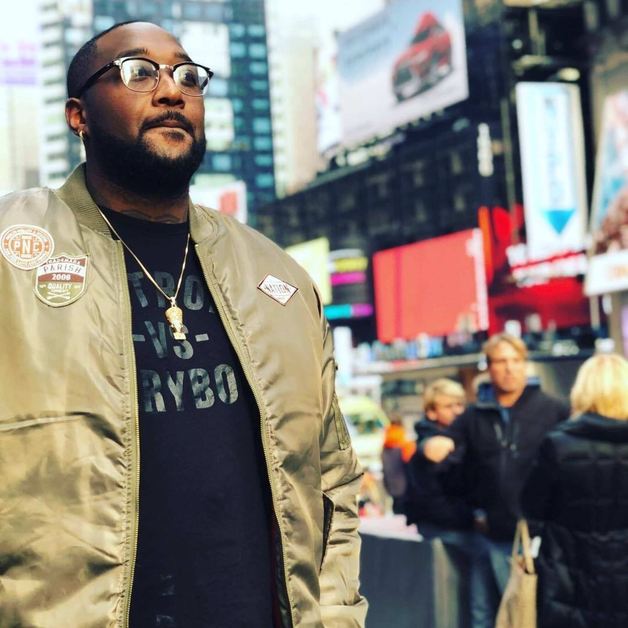 Thomas Fields Jr. standing in Times Square.